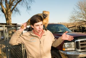 Patrick Starr with an animal on his shoulders