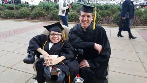 Siblings Danielle and Chris Tadych are all smiles on graduation day.