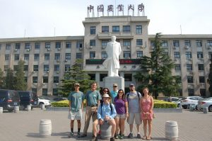 Auburn Maymester 2016 participants pose with one of China's 2,000 statues honoring Chairman Mao Zedong.
